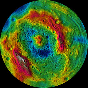 Rheasilvia - Elevation map of Vesta's southern hemisphere. Higher elevations (red) are found on the crater rim (occluding Veneneia) and the central peak.