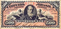 Photograph of a banknote containing a picture of a bearded man in the center and the number 500 printed in the corners
