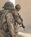 Paratrooper Returns Fire in Afghanistan MOD 45149806.jpg