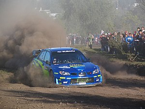 Petter Solberg driving his Subaru Impreza WRC ...