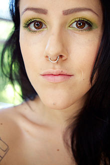 Two Nose Rings On Each Side