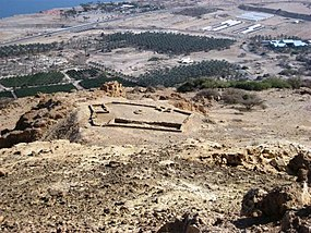 Excavated temple of Ein Gedi with background of modern Kibbutz and Dead Sea.