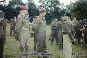 Nigel Poett - Brigadier Poett conferring with General Sir Bernard Montgomery. Poett had just been decorated by the Commander of the United States First Army, General Omar Bradley on behalf of President Roosevelt at General Montgomery's Headquarters in Normandy.