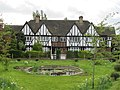 Pond, green and mock-Tudor house - geograph.org.uk - 1840051.jpg