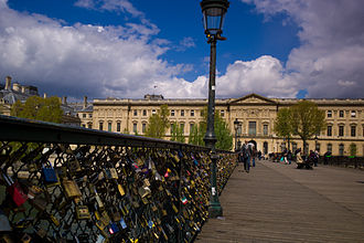 Pont des Arts - Love padlocks on the bridge, view on the Louvre side