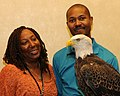 Posing for picture with Bald Eagle. (10594570096).jpg