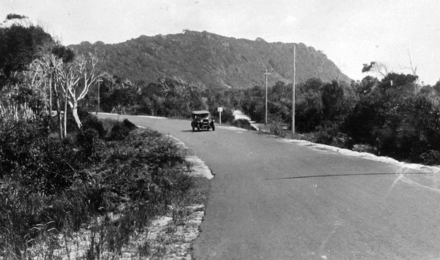 Pacific Highway near Burleigh Heads, ~1934 Queensland State Archives 2083 Main Pacific Highway near Burleigh Heads with Big Burleigh in the background c 1934.png