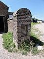 Ramousies (Nord, Fr) chapelle N.D. de Walcourt (mur portail ferme).jpg