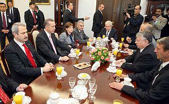 Binali Yıldırım - Yıldırım accompanying Recep Tayyip Erdoğan on a visit to the Polish Senate in 2009