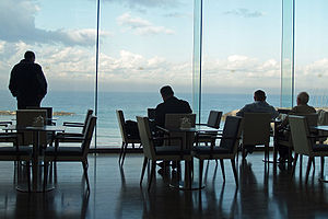 Flat glass - Plate glass is often used in windows, such as at this cafe in Tel Aviv, Israel overlooking the Mediterranean Sea.