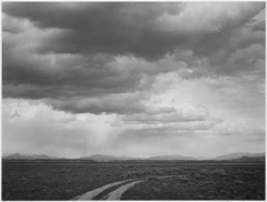 "Roadway, low horizon, mountains, clouded sky, ""Near (Grand) Teton National Park,"", 1933 - 1942 - NARA - 519911.tif"
