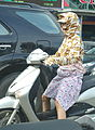 Robbit - woman on scooter in Hanoi, Vietnam - DSC05759.JPG