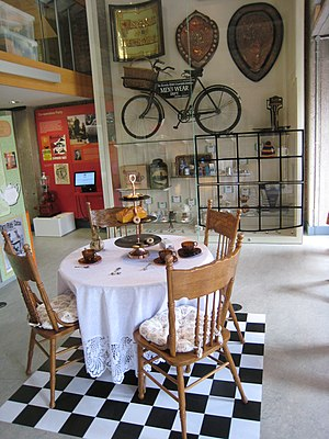 Rochdale Pioneers Museum - Part of the first floor: a tea table showing Co-op tea, biscuits, cakes