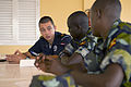 Royal Netherlands Navy Cpl. Jeroen Ravensburg, left, discusses combat casualty care with Ugandan service members during exercise Cutlass Express 2013 at the Port of Djibouti in Djibouti Nov. 13, 2013 131113-F-NJ596-001.jpg
