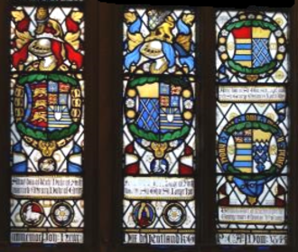 George Manners, 11th Baron de Ros - Heraldic glass in the Rutland Chapel, St George's Chapel, Windsor Castle, erected in 1849 by Charles Manners, 6th Duke of Rutland. It shows far left the arms of Anne of York, Duchess of Exeter (1439-1476) impaled by the arms of her 1st husband Henry Holland, 3rd Duke of Exeter. To the right of the last are her arms impaled by the arms of her 2nd husband Sir Thomas St Leger (c.1440-1483), KG. The rightmost window shows top: the arms of Anne's daughter Anne St Leger impaled by the arms of her husband George Manners, 11th Baron de Ros (c.1470-1513). Below are the arms of his son Thomas Manners, 1st Earl of Rutland (c.1492-1543) impaling the arms of his 2nd wife Eleanor Paston