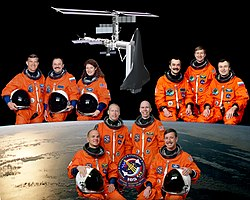 Crew of the space shuttle mission STS-105 (bottom) together with the crew of ISS expedition 3 (top right) and the crew of ISS expedition 2 (top left).