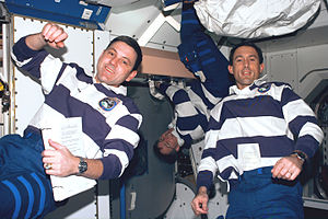 Timex Datalink - Astronaut James H. Newman (right) wears the Timex Datalink 50 model 70502 on STS-88