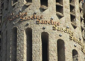 "Sanctus - Detail of a tower decorated with the word ""Sanctus"""