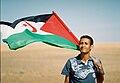 Sahrawi with flag.jpg