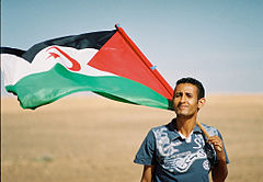 Sahrawi with flag.jpg