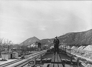 California Southern Railroad - A westbound train pauses at Cajon siding to cool its wheels before continuing down the pass in March 1943. The station and facilities are at left.