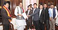 Sarbananda Sonowal along with a delegation from North East, presenting a Memorandum to the Union Home Minister, Shri Rajnath Singh, in New Delhi on December 23, 2015.jpg