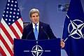 Secretary Kerry Addresses Reporters During a News Conference at NATO in Brussels (31352309141).jpg