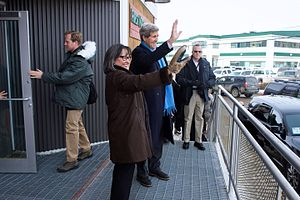 Leona Aglukkaq - Arctic Council Chairman Leona Aglukkaq and U.S. Secretary of State John Kerry wave to people in her hometown of Iqaluit