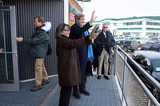 Leona Aglukkaq - Arctic Council Chairman Leona Aglukkaq and U.S. Secretary of State John Kerry wave to people in her hometown of Iqaluit