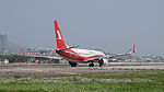 Shanghai Airlines Boeing 737-86D B-5832 Taking off from Taipei Songshan Airport 20150314.jpg