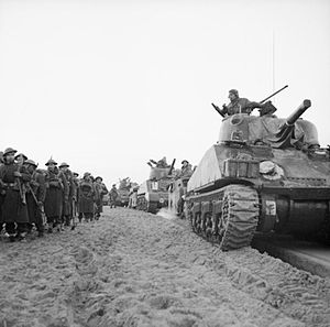 Sherman tanks of 23rd Armoured Brigade come ashore with infantry at Anzio, Italy, 22 January 1944. NA11037.jpg