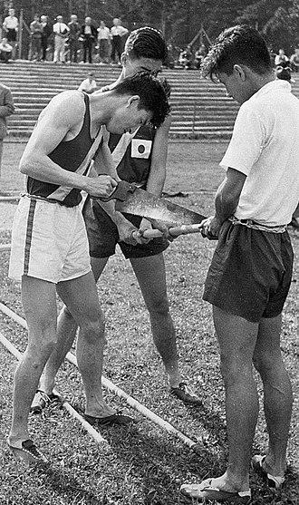 Shuhei Nishida - Shuhei Nishida (left), Sueo Oe and Kiyoshi Adachi are adjusting a pole at the 1936 Olympics