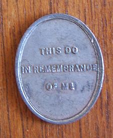 Many Presbyterian churches historically used communion tokens to provide entrance to the Lord's Supper. South Leith communion token reverse.jpg