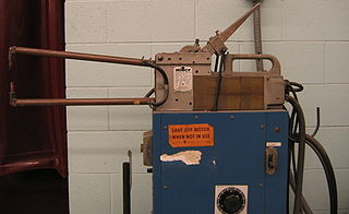 Spot welding A process in which contacting metal surfaces are joined by heat from resistance to electric current