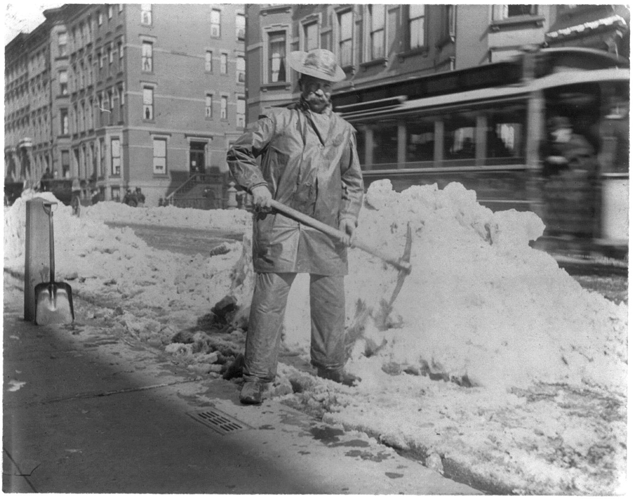File:Street types of New York City- Street cleaner with pick ax standing in front of pile of snow LCCN2002699104.jpg