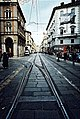 Streetcar tracks on a cobbled street.jpg