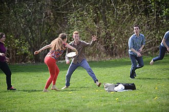 Mixed-sex sports - A mixed-sex group of people playing frisbee