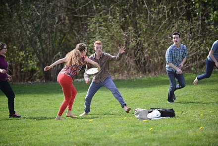 A mixed-sex group of people playing frisbee Students playing frisbee 02 (17070420895).jpg