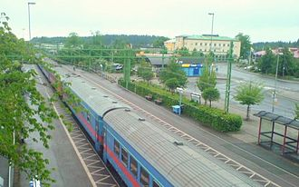 Southern Main Line - Train departure from Sävsjö in direction versus Stockholm and view over Sävsjö's central parts
