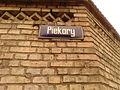 Tabliczka z nazwą ulicy Piekary na murach Aresztu Śledczego w Toruniu.jpg