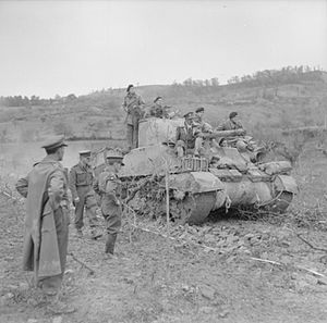 3rd County of London Yeomanry (Sharpshooters) - A Sherman tank of 3rd CLY negotiates a newly-laid road surface, constructed over soft ground by 1926 Basuto Company, Royal Pioneer Corps, in the advance towards the Sangro river, Italy, 21 November 1943.
