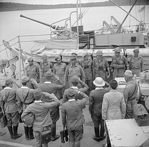 Andaman and Nicobar Islands - Japanese military delegation salute Lieutenant Colonel Nathu Singh, commanding officer of the Rajput Regiment, following their surrender of the Islands, 1945