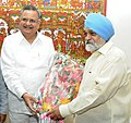 The Chief Minister of Chhattisgarh, Dr. Raman Singh meeting the Deputy Chairman, Planning Commission, Shri Montek Singh Ahluwalia for finalizing plan size for 2013-14 for the State, in New Delhi on July 31, 2013.jpg