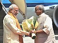 The Prime Minister, Shri Narendra Modi being welcomed by the Governor of Rajasthan, Shri Kalyan Singh, on his arrival, at Jaipur on August 21, 2015.jpg