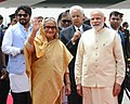 The Prime Minister, Shri Narendra Modi welcomes the Prime Minister of Bangladesh, Ms. Sheikh Hasina, on her arrival, at Air Force Station Palam, in New Delhi.jpg