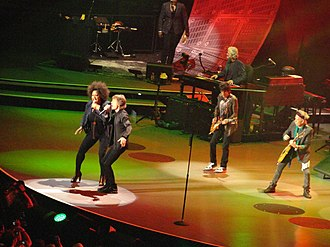 Lisa Fischer - Fischer singing with Jagger and The Rolling Stones during their Fifty and Counting Tour, in Boston Mass., June 12, 2013