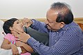 The Union Minister for Health and Family Welfare, Dr. Harsh Vardhan administering the polio vaccine drops to children under-five years to mark the World Polio Day, in New Delhi on October 24, 2014.jpg