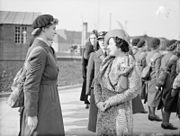 Queen Elizabeth chatting with a WAAF sergeant whilst visiting RAF Innsworth during the Second World War.