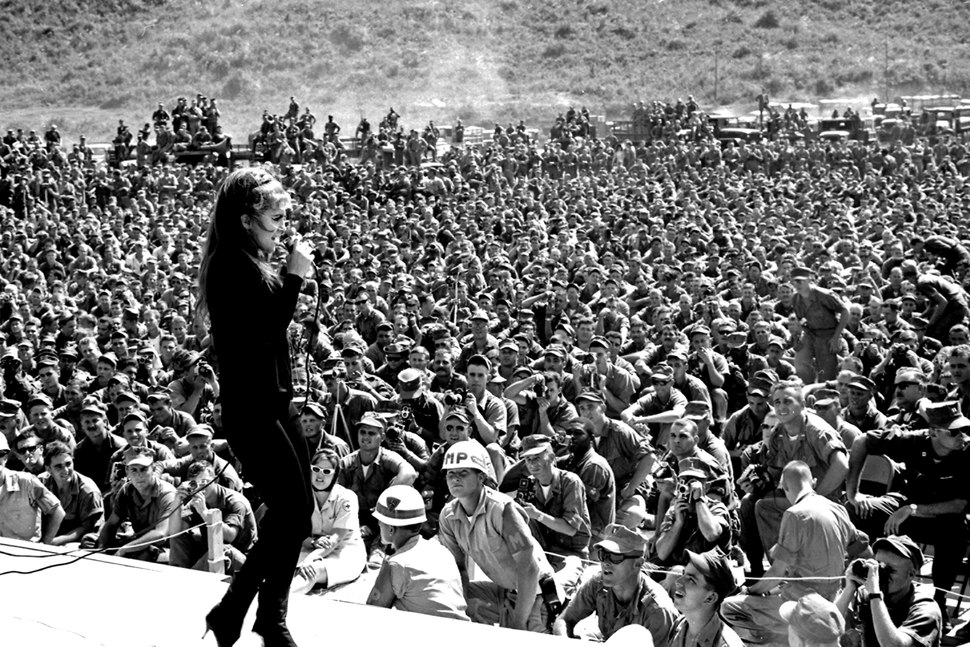 Thousands of service personnel listen to Miss Ann-Margret sing one of her numbers during her show in Danang, Vietnam. - NARA - 532506.tiff