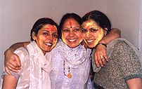 Three women having played Holi with colors, sh...